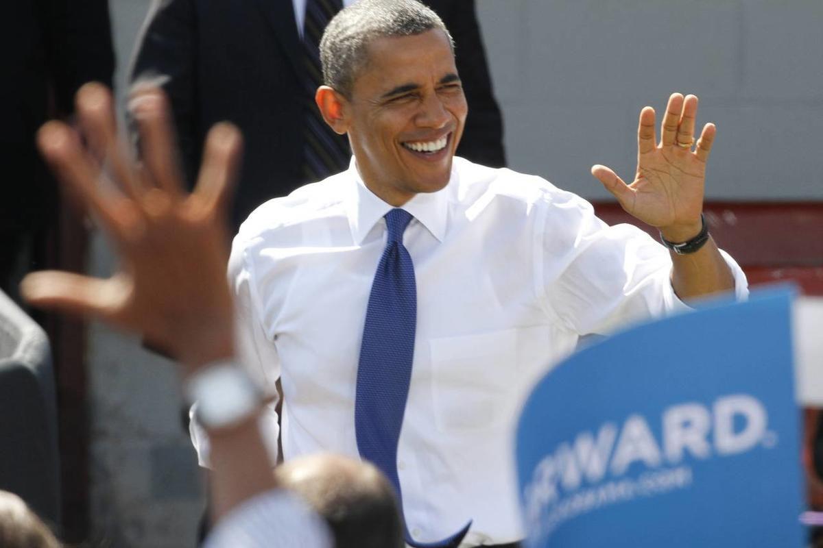 President Barack Obama waves as he arrives for a rally at the G. Richard Pfitzner baseball stadium in Woodbridge, Va., Friday, Sept. 21, 2012.