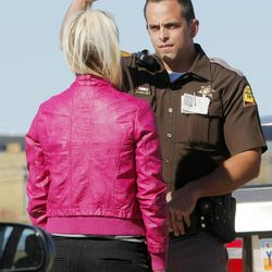 Trooper Mike Singleton conducts a roadside sobriety test Wednesday, Oct. 17, 2012, on a female driver on Bangerter Highway near 1300 South. The woman was arrested for investigation of drunken driving.