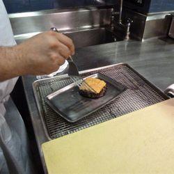 Applying the  lemongrass-chili butter.