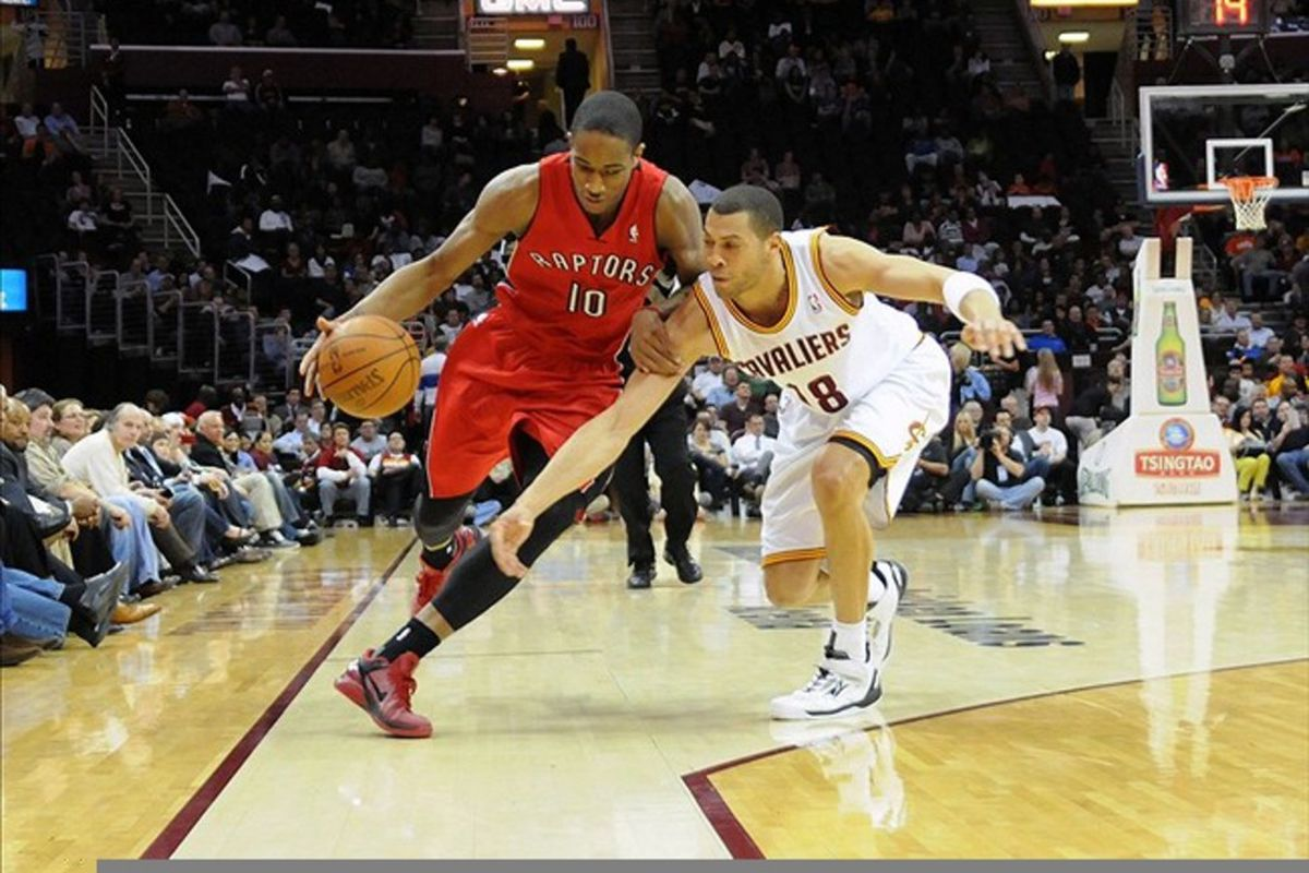 March 13, 2012; Cleveland, OH, USA: Toronto Raptors shooting guard DeMar DeRozan (10) dribbles around Cleveland Cavaliers shooting guard Anthony Parker (18) during the game at Quicken Loans Arena.  Mandatory Credit: Eric P. Mull-USPRESSWIRE