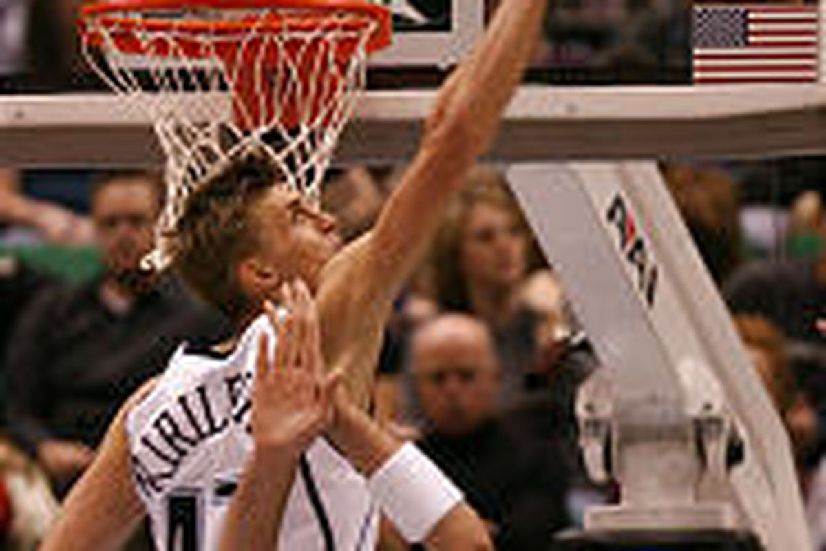 Utah's Andrei Kirilenko blocks a shot during the Jazz's lopsided loss to the Pacers at the Delta Center on Tuesday night. Kirilenko returned from an injury.