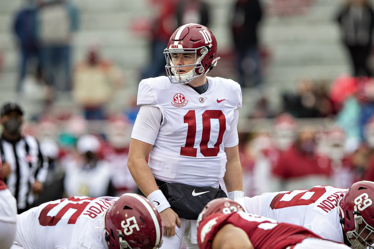 Mac Jones of the Alabama Crimson Tide looks to the sidelines for the play in the first half of a game against the Arkansas Razorbacks at Razorback Stadium on December 12, 2020 in Fayetteville, Arkansas