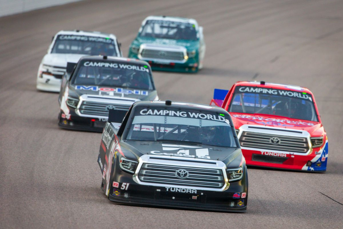Gander RV and Outdoors Truck Series driver Kyle Busch (51) leads a group into turn 1 during the Wise Power 200 on May 1st, 2021 at the Kansas Speedway in Kansas City, Kansas.