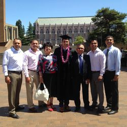Antonio Lopez stands with his parents and four brothers after graduating from the University of Washington with his Doctor of Dentistry degree.