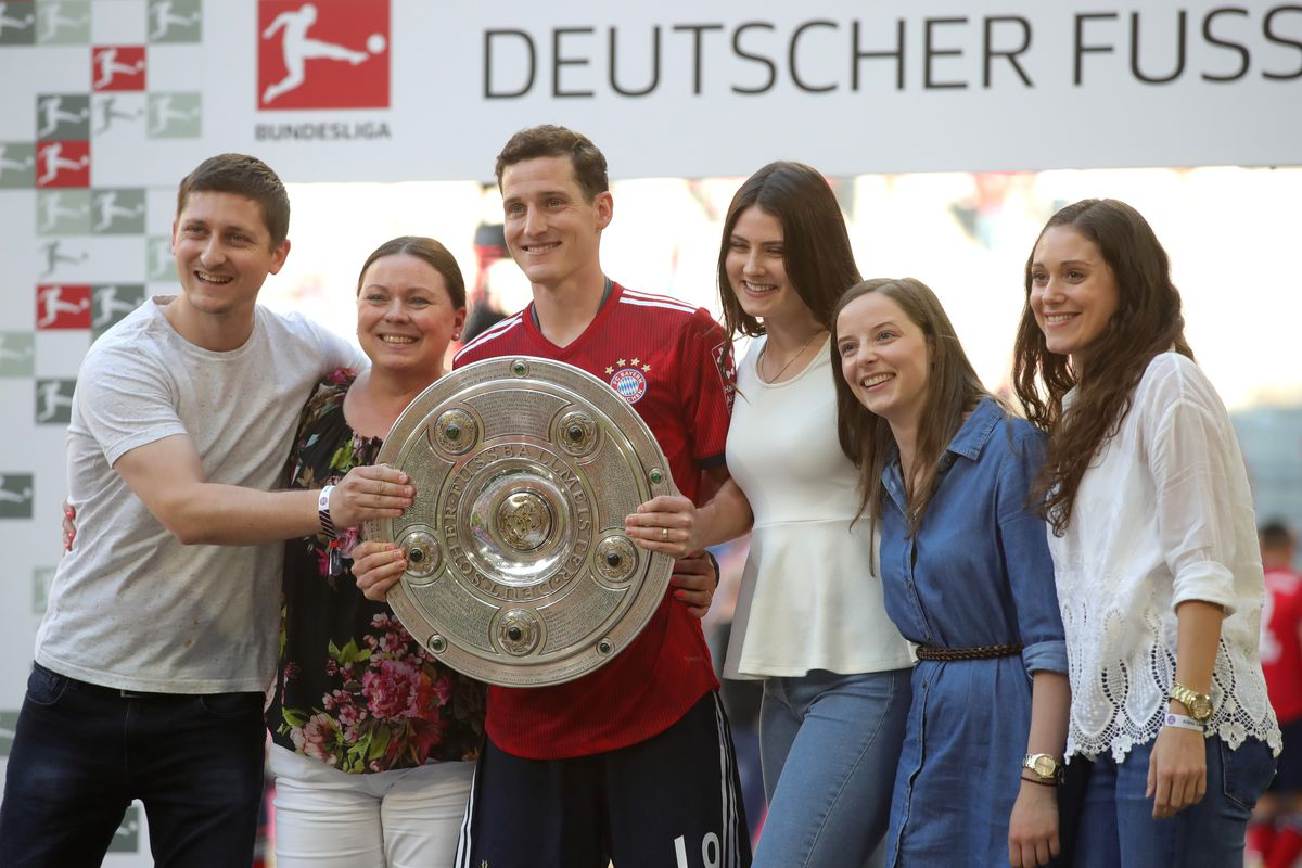 MUNICH, GERMANY - MAY 12: Sebastian Rudy of Bayern Muenchen celebrates with the trophy during the Bundesliga match between FC Bayern Muenchen and VfB Stuttgart at Allianz Arena on May 12, 2018 in Munich, Germany.