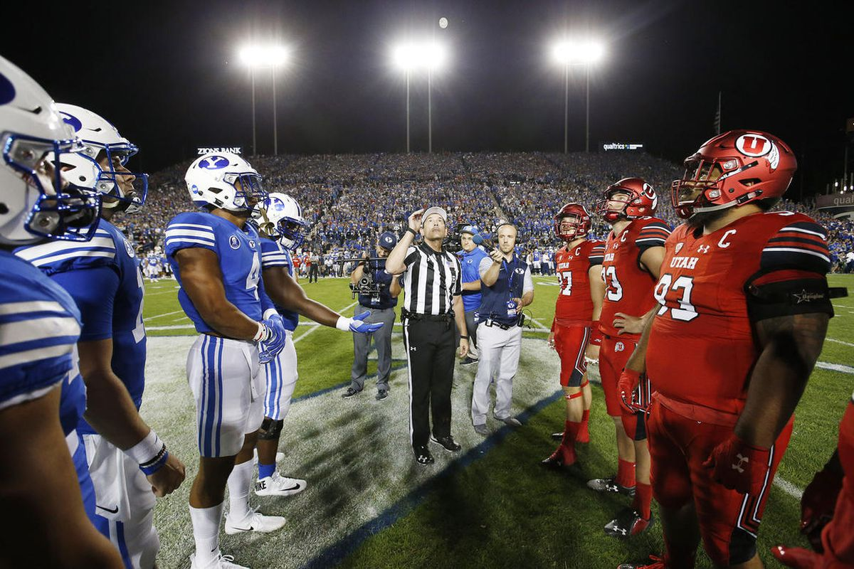 Team captains meet for the coin toss before the BYU-Utah game on Saturday, Sept. 9, 2017. BYU named eight captains on Friday, Sept. 4, 2020 for the 2020 season, but only one player per team will be allowed to participate in the coin toss this year due to the COVID-19 pandemic.