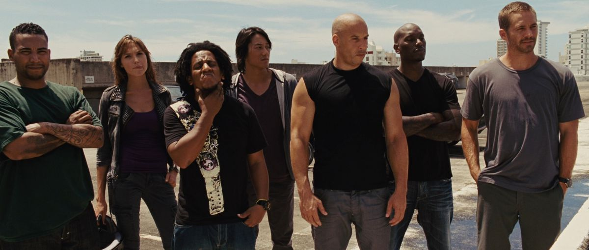 the family of fast and furious lined up looking tough