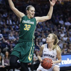 Brigham Young Cougars guard Makenzi Morrison Pulsipher (23) tries to shoot over San Francisco Lady Dons forward Taylor Proctor (32) during the WCC tournament championship in Las Vegas Tuesday, March 8, 2016. San Francisco won 70-68.