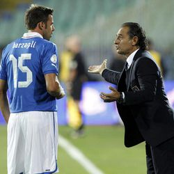 Italy's Andrea Barzagli, left, listens to his coach Cesare Prandelli during the Group B 2014 World Cup qualifying match against Bulgaria at the Vassil Levski stadium in Sofia, Friday, Sept. 7, 2012.