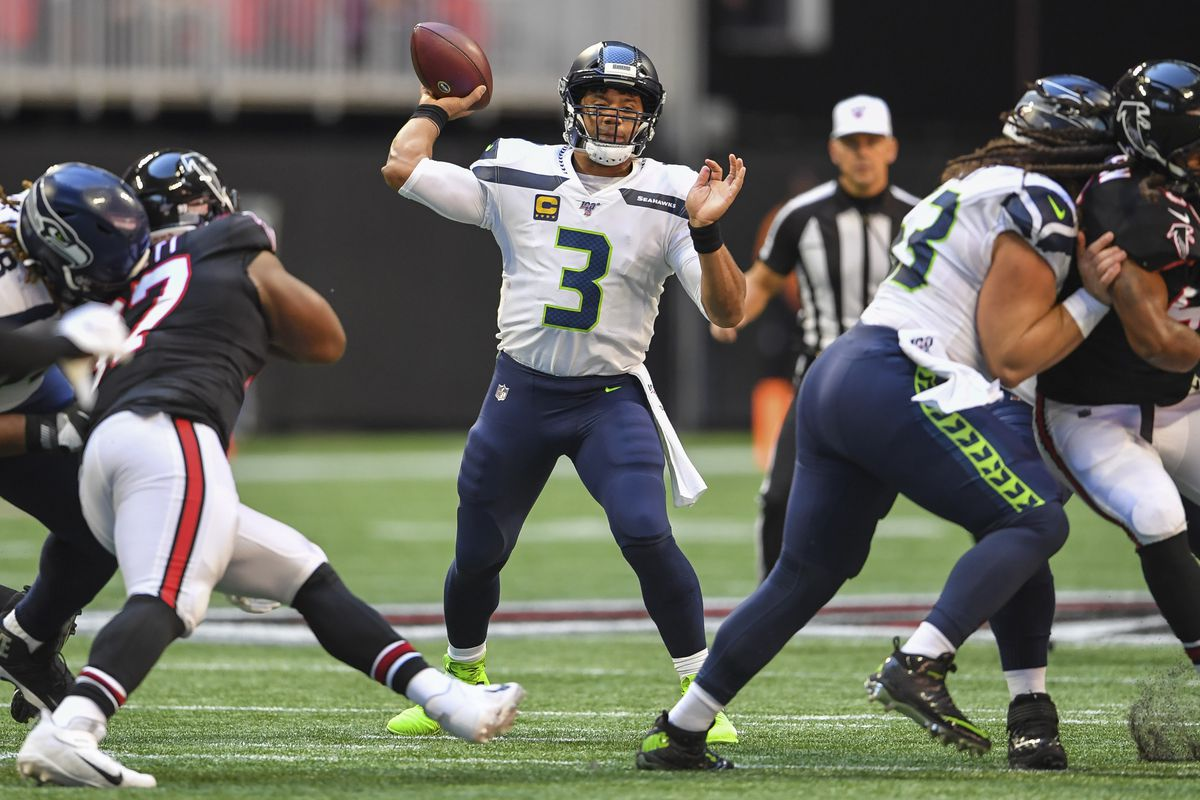 Seattle Seahawks quarterback Russell Wilson throws a pass against the Atlanta Falcons during the first quarter at Mercedes-Benz Stadium.
