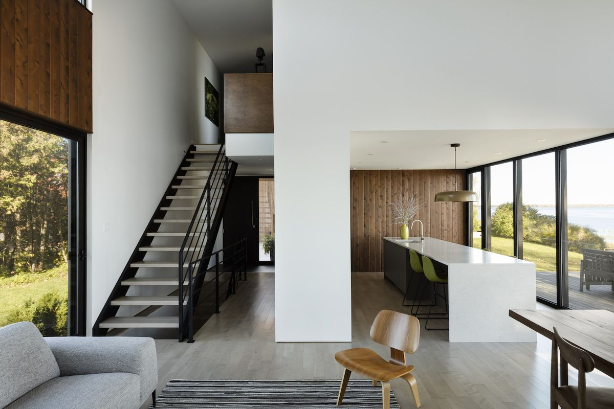 Living room with stairs leading to second floor.