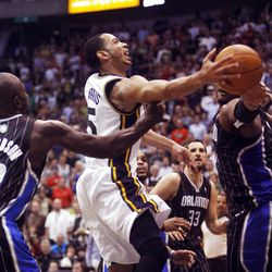 Utah Jazz guard Devin Harris (5) flies to the hoop for a layup as the Utah Jazz and the Orlando Magic play Saturday, April 21, 2012 in Energy Solutions arena.