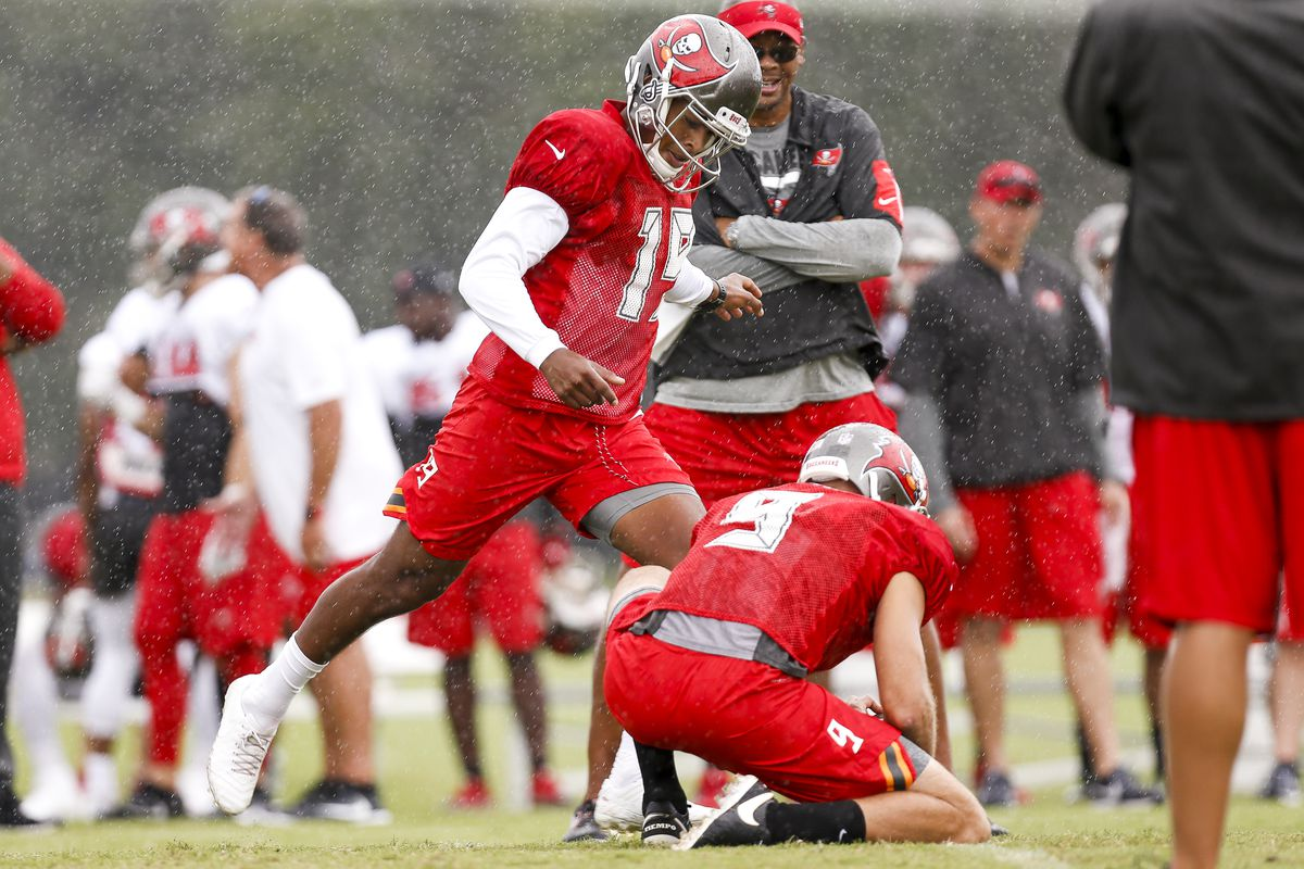 Kicker Roberto Aguayo and Punter/Holder Bryan Anger of the Tampa Bay Buccaneers works out during Training Camp at One Buc Place on July 30, 2017 in Tampa, Florida.