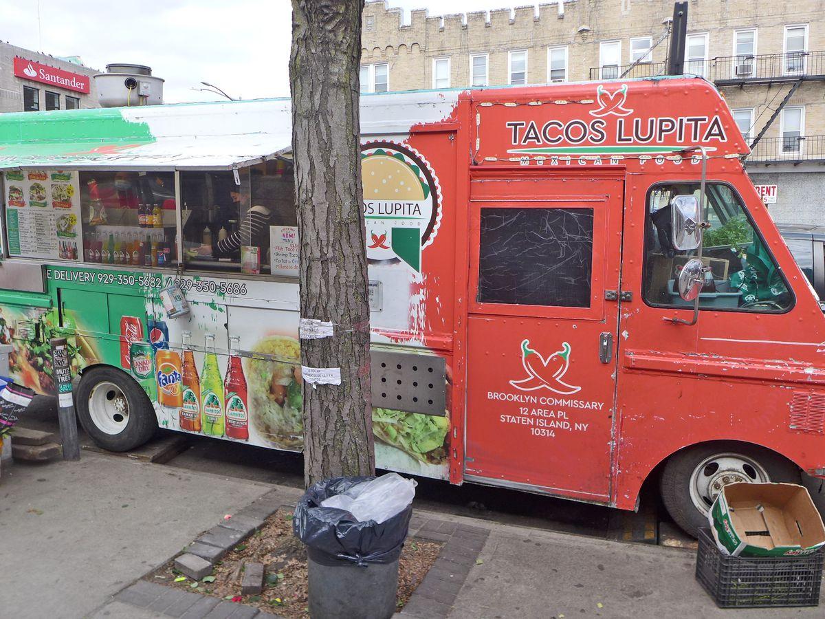 An orange and green taco truck.