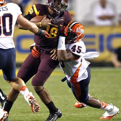 Arizona State quarterback Michael Eubank (18) tries to break the tackle of Illinois linebacker Jonathan Brown (45) during the first half of an NCAA college football game, Saturday, Sept. 8, 2012,in Tempe, Ariz.