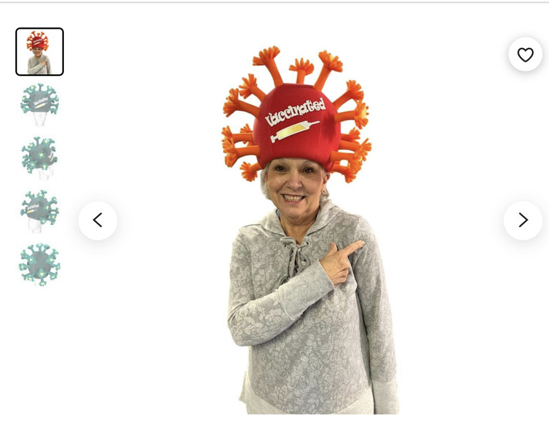 """A foam party hat in the shape of a coronavirus with the word """"vaccinated"""" printed on it."""