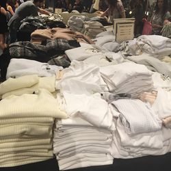The table of women's tees, tops, and sweaters, $65—$135