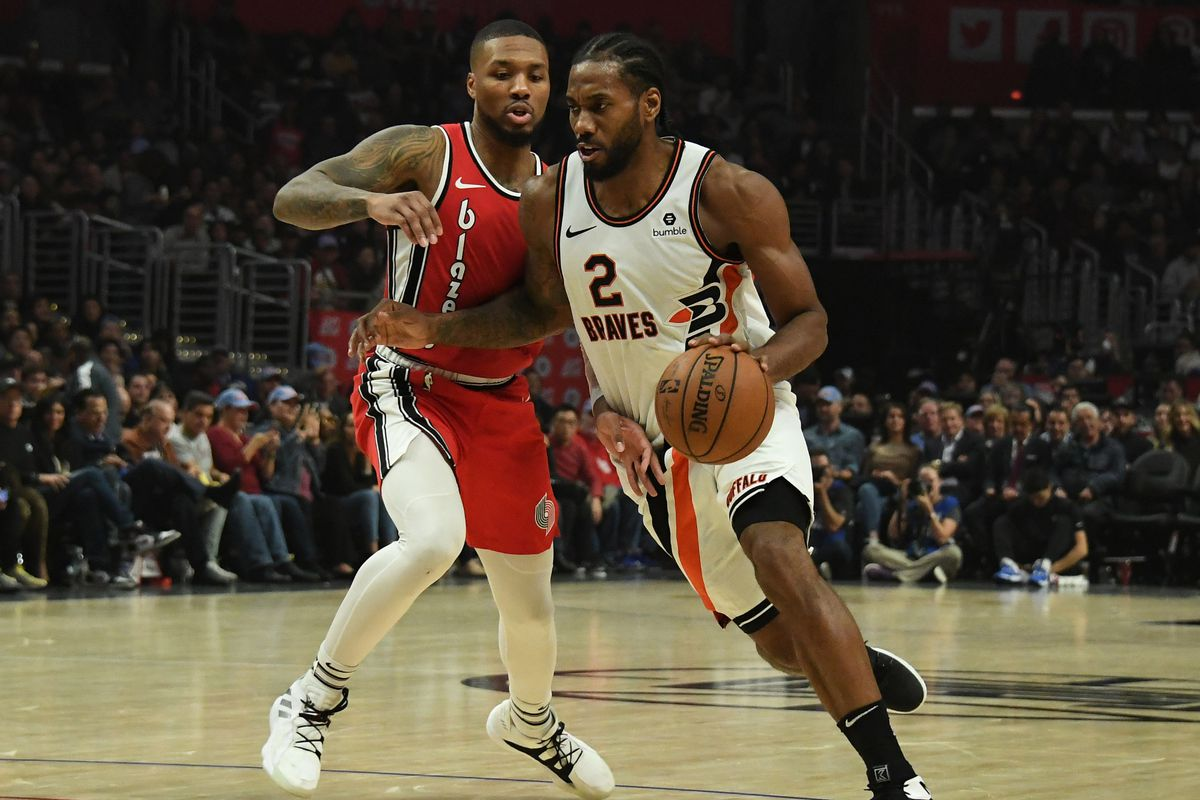 Los Angeles Clippers forward Kawhi Leonard moves the ball against Portland Trail Blazers guard Damian Lillard during the second half at Staples Center.