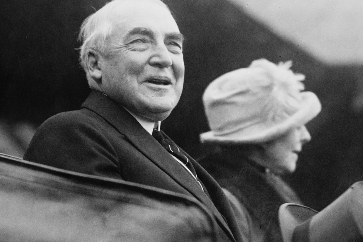 President Warren G Harding (1865–1923) and First Lady Florence Harding, leaving Pier 14, the US Army Port of Debarkation at Hoboken, New Jersey, after a memorial service held on the return of more than 5,000 American war dead from France.