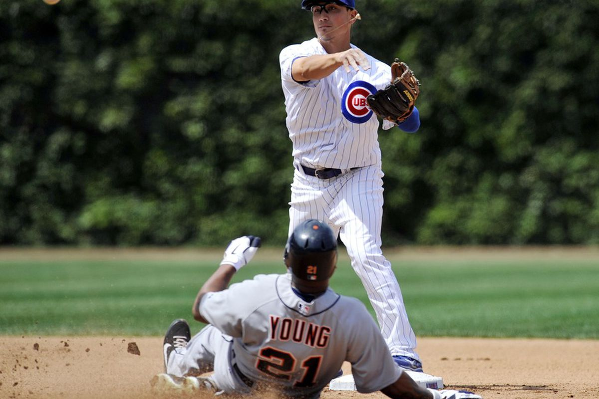 June 14, 2012; Chicago, IL, USA; Chicago Cubs second baseman Darwin Barney (15) forces out Detroit Tigers left fielder Delmon Young (21) at second base in the fourth inning at Wrigley Field.  Mandatory Credit: David Banks-US PRESSWIRE