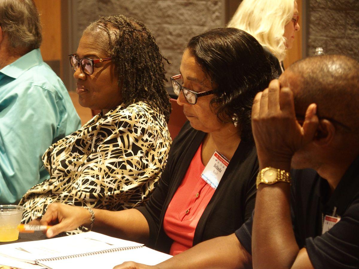 Belinda Rozell, center, a school board member in Tipton County