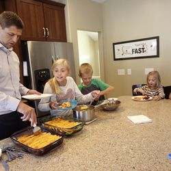 Matthew Grant dishes out dinner with his children Mary, Dallin, Grace and Camilla at their home in Midvale, Utah, on Monday, Sept. 9, 2019.