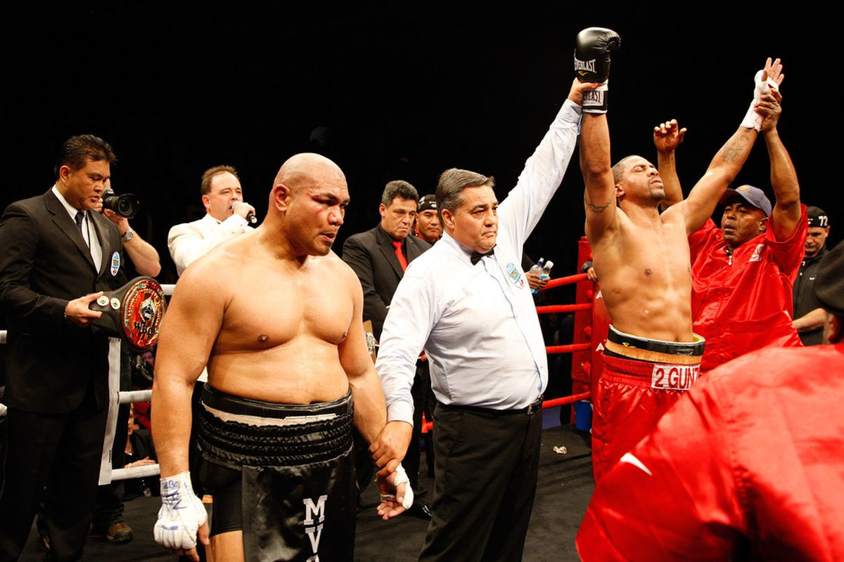 After two close real fights, Monte Barrett and David Tua are interested in taking their rivalry to WWE next year. (Photo by Leon Rose/Getty Images)