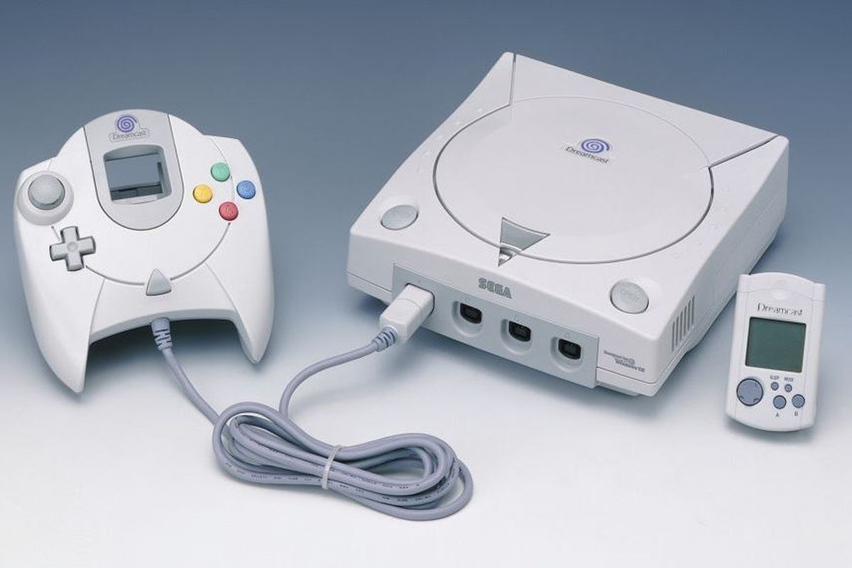 product photo of Sega Dreamcast controller hooked up to Sega Dreamcast, with VMU to the right of the console
