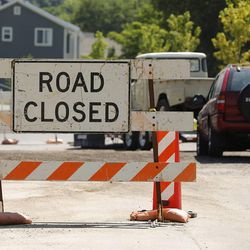 Motorists drive through road construction in Bountiful, Tuesday, June 30, 2015. Eighty Utah cities and towns passed or considered resolutions this month to support increased transportation funding to meet critical community needs. The funding option was made possible by HB 362.