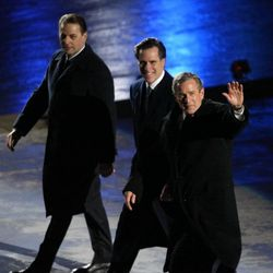 IOC President Dr. Jaques Rogge, SLOC President Mitt Romney and the President of the United States George W. Bush wave the crowd before moving to their seats during the Salt Lake 2002 Olympic Winter Games opening ceremonies at Rice-Eccles Stadium, Friday, Feb. 8, 2002.