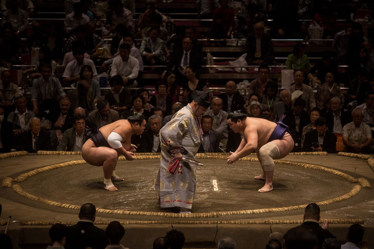 Wrestlers facing off in a Tokyo Grand Sumo tournament