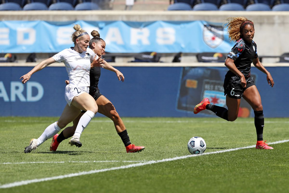 North Carolina Courage forward Kristen Hamilton (23) and Chicago Red Stars defender Sarah Gorden battle for the ball as Red Stars defender Casey Krueger (6) closes in during the second half of an NWSL soccer match on June 5 at SeatGeek Stadium.