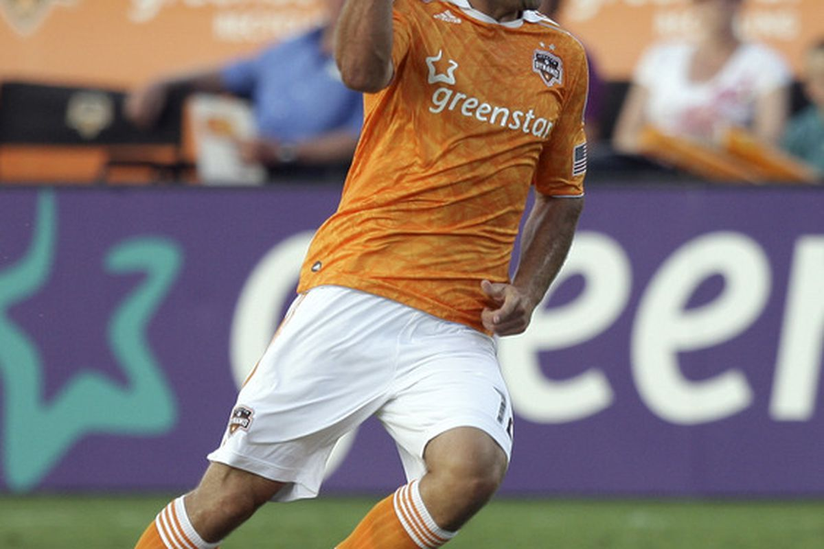 HOUSTON - JUNE 11:  Will Bruin #12 of the Houston Dynamo reacts after being called offsides on the play against Chivas USA in the first half at Robertson Stadium on June 11, 2011 in Houston, Texas.  (Photo by Bob Levey/Getty Images)
