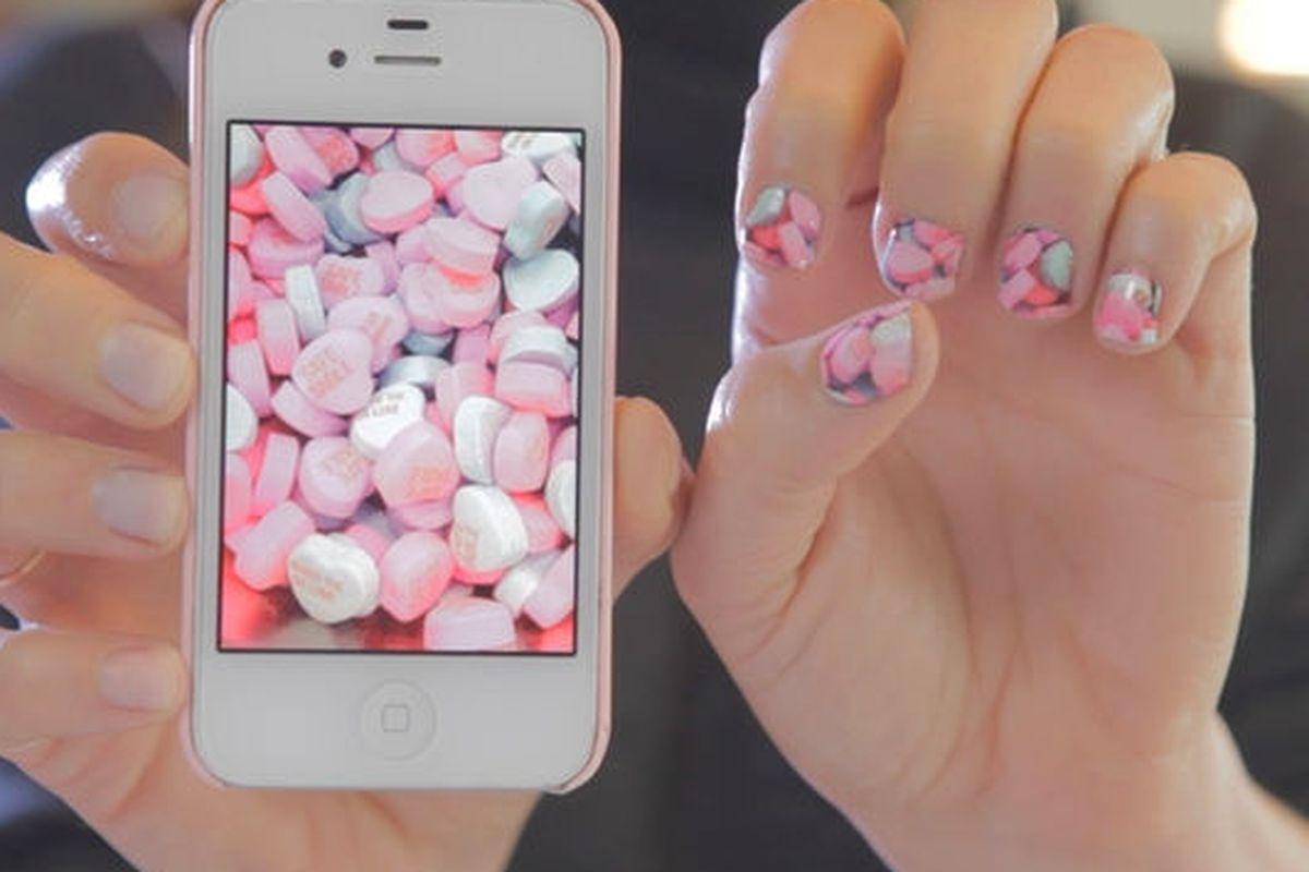 "Image via NailSnaps/<a href=""https://www.kickstarter.com/projects/angelanderson/nailsnaps-turn-your-photos-into-nail-polish-sticke"">Kickstarter</a>."