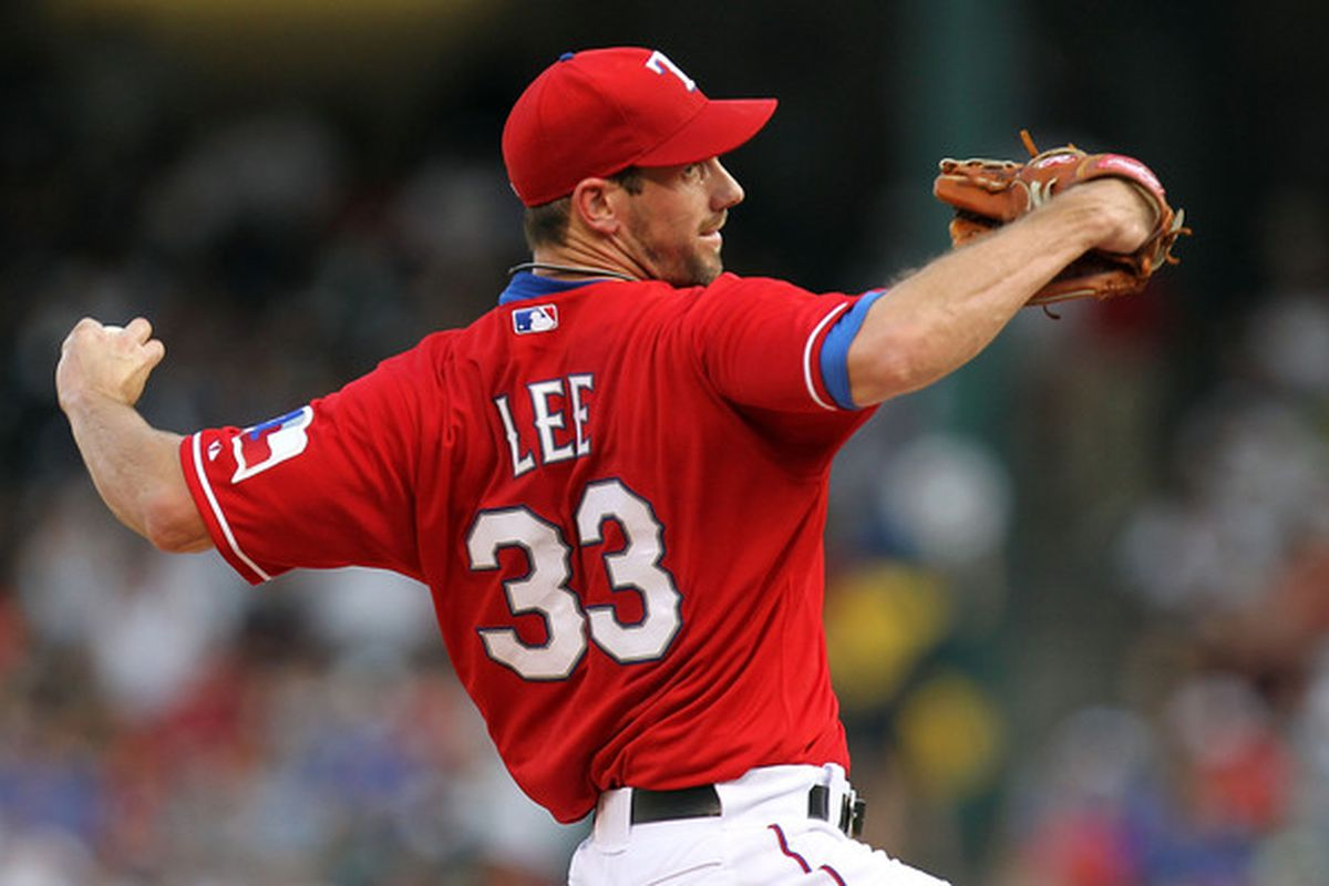 ARLINGTON TX - JULY 22:  Pitcher Cliff Lee #33 of the Texas Rangers throws against the Los Angeles Angels of Anaheim on July 22 2010 at Rangers Ballpark in Arlington Texas.  (Photo by Ronald Martinez/Getty Images)