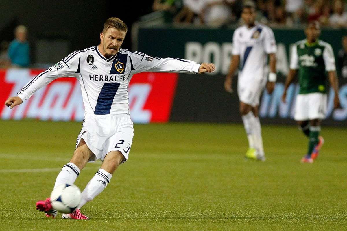 PORTLAND, OR - JULY 14:  David Beckham #23 of the Los Angeles Galaxy kicks the ball against  the Portland Timbers on July 14, 2012 at Jeld-Wen Field in Portland, Oregon.  (Photo by Jonathan Ferrey/Getty Images)