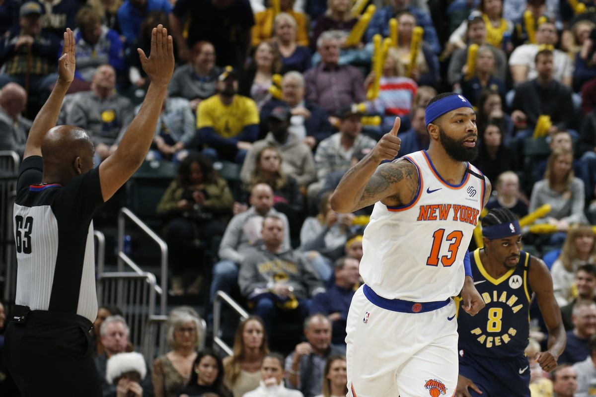 New York Knicks forward Marcus Morris Sr. reacts to making a three point shot against the Indiana Pacers during the third quarter at Bankers Life Fieldhouse.