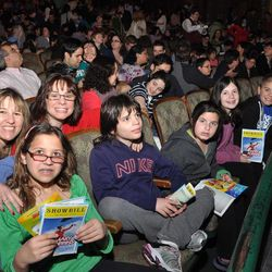 """In this April 29, 2012 photo released by the Theatre Development Fund, kids attend at an autism-friendly performance of the musical """"Mary Poppins, in New York. About 40 autism specialists _ many master's students at Hunter College, special education experts or social workers _ roamed the theater, providing comfort and help to families."""