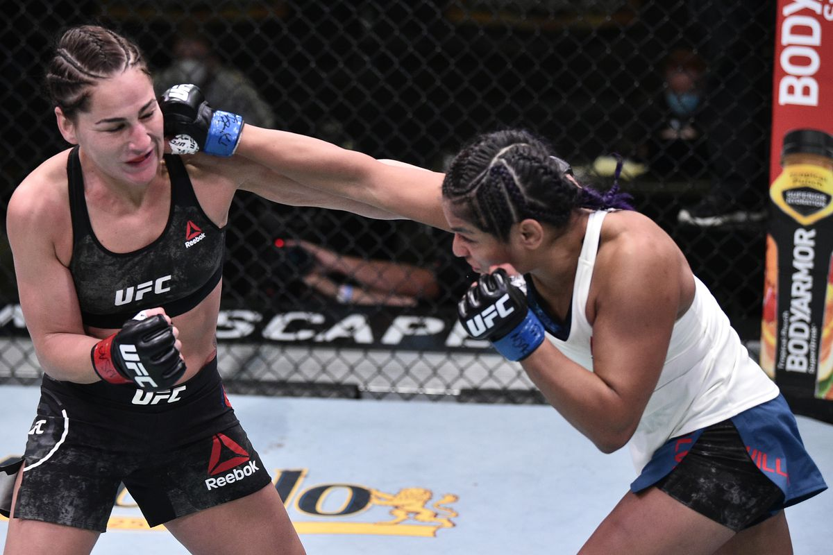Cynthia Calvillo punches Jessica Eye in their flyweight fight during the UFC Fight Night event at UFC APEX on June 13, 2020 in Las Vegas, Nevada.