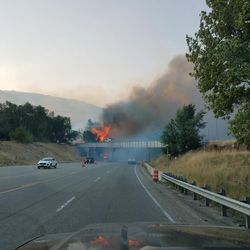 A grass fire fueled by canyon winds has shut down Highway 89 at the mouth of Weber Canyon.