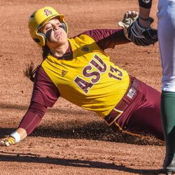 ASU sophomore catcher Maddi Hackbarth (13) slides safely into third base during the Sun Devils' 10-2 victory in five innings over NDSU on Friday, Mar. 30, 2018 at the Alberta B. Farrington Softball Stadium in Tempe, Arizona.