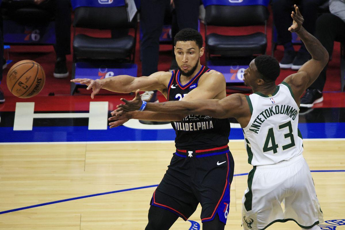 Ben Simmons of the Philadelphia 76ers passes against Thanasis Antetokounmpo of the Milwaukee Bucks during the first quarter at the Wells Fargo Center on March 17, 2021 in Philadelphia, Pennsylvania.