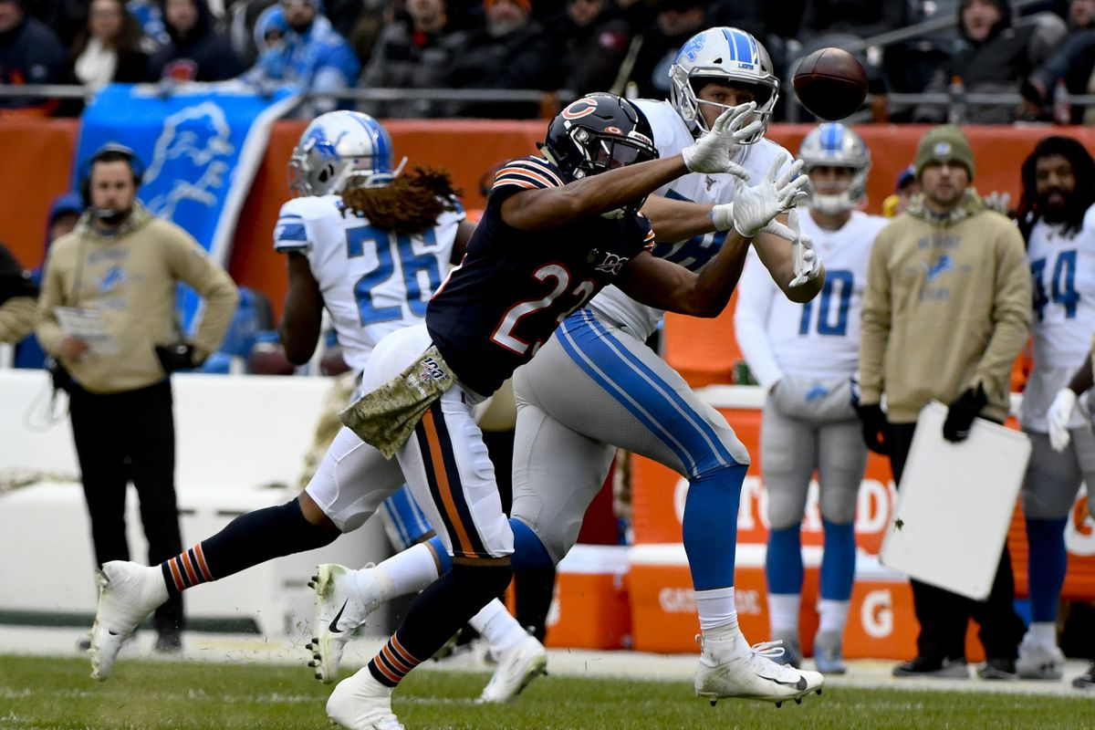 Detroit Lions tight end T.J. Hockenson and Chicago Bears cornerback Kyle Fuller fight for a pass in the second half at Soldier Field.