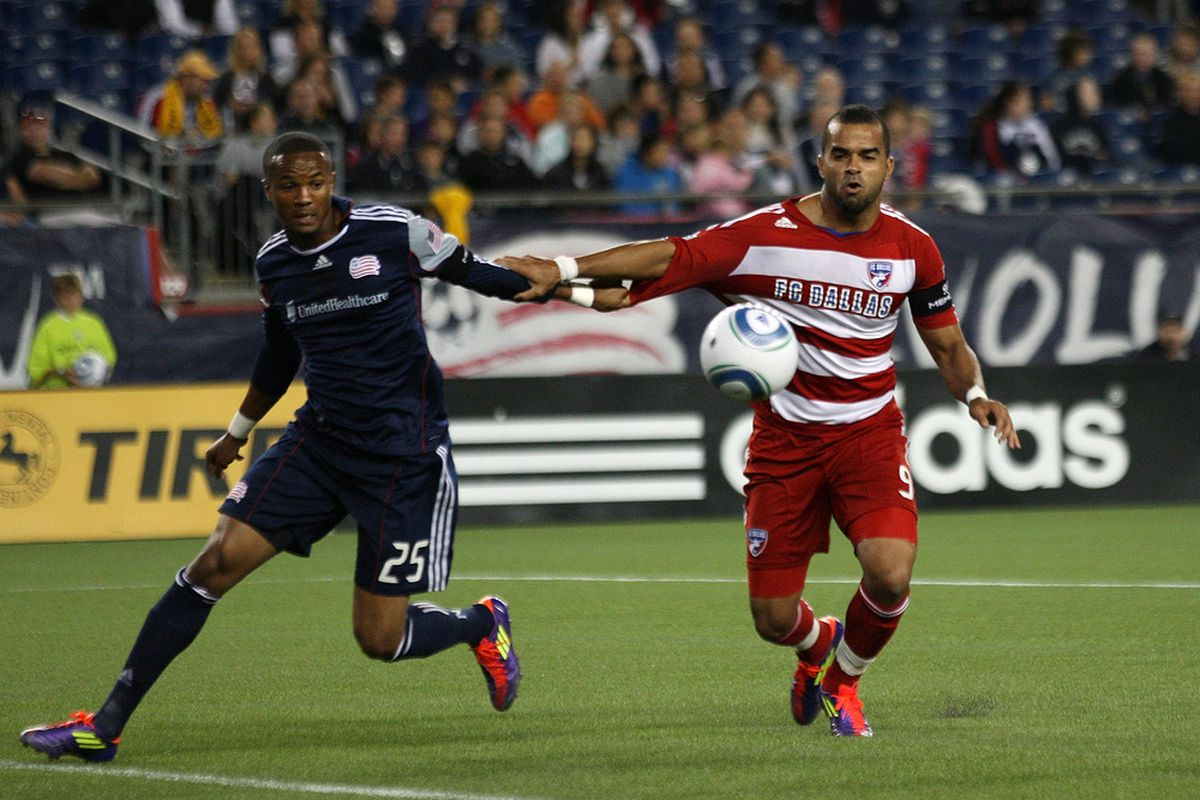 FOXBORO, MA - SEPTEMBER 10:  Darrius Barnes #25 of the New England Revolution battles Maicon Santos #9 of the FC Dallas at Gillette Stadium on September 10, 2011 in Foxboro, Massachusetts. (Photo by Jim Rogash/Getty Images)