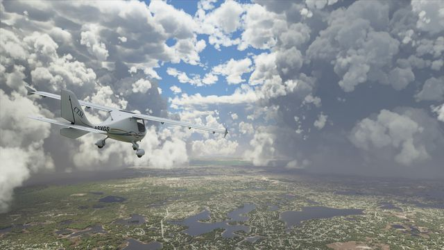 a Cessna flies through partly cloudy skies with a green tapestry beneath it in Microsoft Flight Simulator