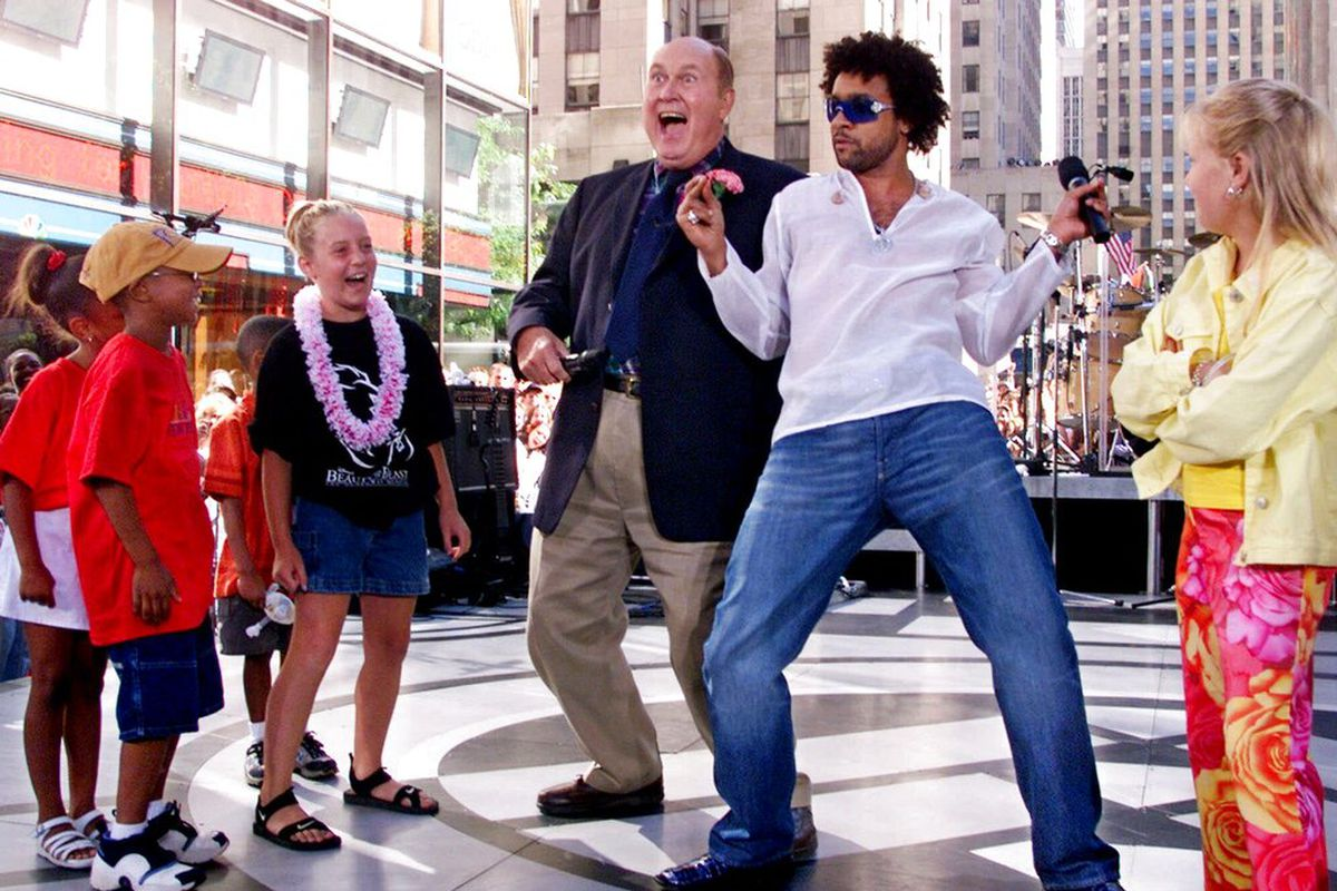 """""""Today"""" show weatherman Willard Scott, center left, gets a hip-shaking lesson from Shaggy. Scott has died at age 87."""