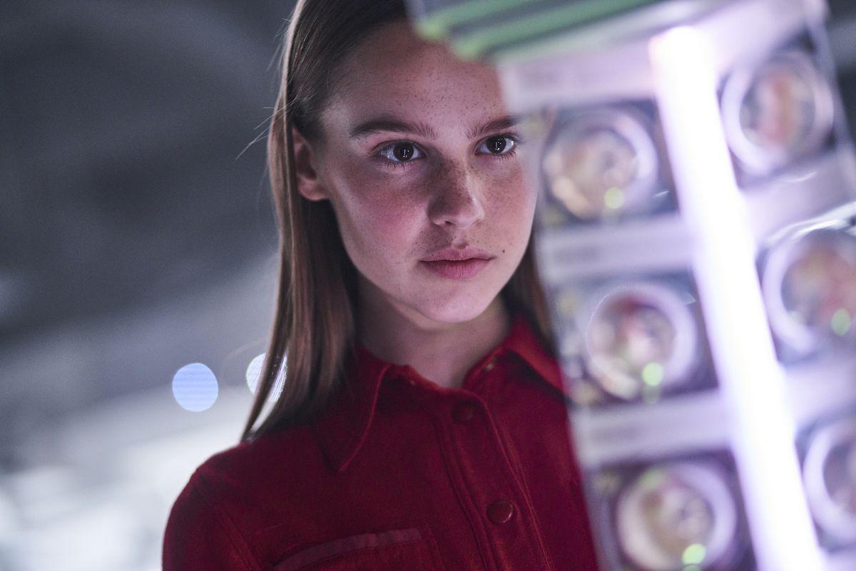 Daughter (Clara Rugaard) surveying embryos.