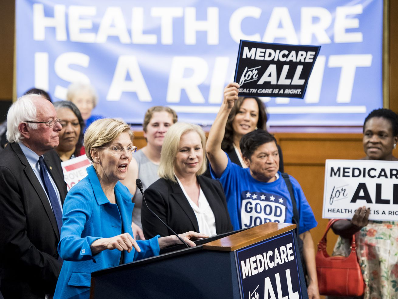 Presidential candidates Bernie Sanders (left), Elizabeth Warren (second from left), Kirsten Gillibrand (front, third from left), and Kamala Harris (back, second from right) rally in favor of Medicare-for-all in 2017.