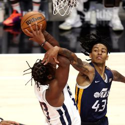 Utah Jazz White team guard/forward Elijah Hughes (33) is fouled by Utah Jazz Blue team guard Kyle Allman (43) under the basket as the Utah Jazz Blue and White teams play in summer league action at Vivint Smart Home Arena in Salt Lake City on Friday, Aug. 6, 2021. The White team won 83-65.