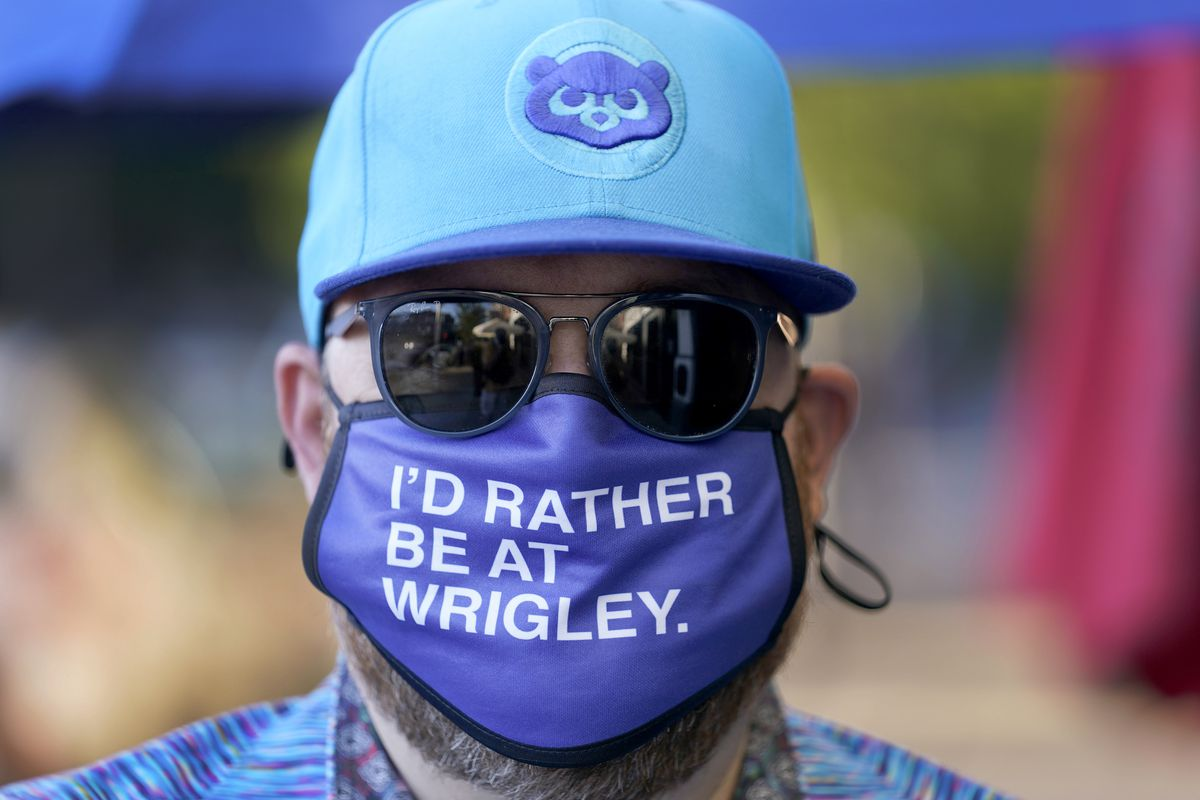 Patrick McCarron wears a Cubs cap and face mask as he heads to a rooftop bar for a game. The Cubs averaged 38,208 fans for their 81 home dates in 2019, trailing only the Los Angeles Dodgers, Cardinals and Yankees. Now, those crowds are gone.